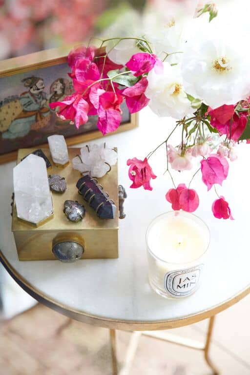 Healing crystals, pretty blooms and a sweetly scented 'Jasmin'candle by Diptyque take pride of place
