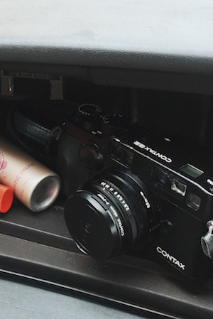 in her glovebox: Impulse and a Contax camera