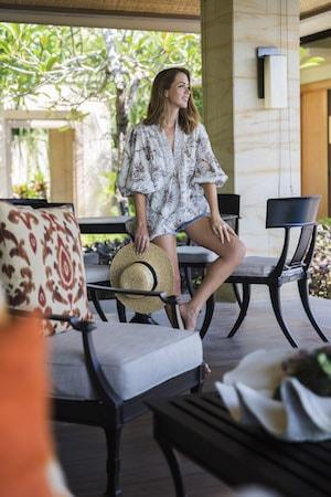 ikat cushions in the villa. wearing zimmermann